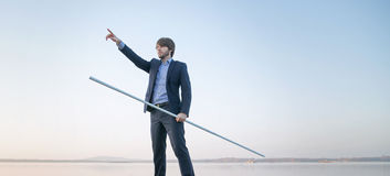 Handsome manager holding long stick Stock Image