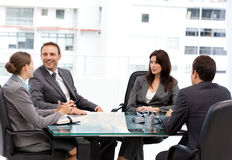 Handsome manager laughing during a meeting Royalty Free Stock Photo