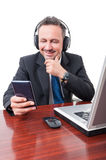 Handsome manager listening music on headphones Stock Image