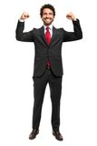 Handsome manager raising arms in sign of victory Stock Photos