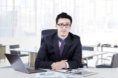 Handsome manager sitting in the office Stock Images