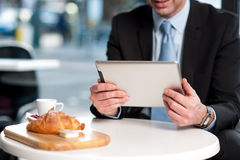 Handsome manager using his tablet device Royalty Free Stock Photography