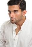 Handsome masculine man face. Masculine man profile looking intently or with macho attitude. White background stock image