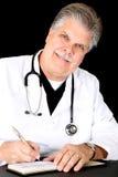 Handsome mature blue eyed medical doctor smiling w Stock Image