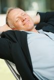 Handsome mature business man relaxing Stock Image