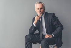 Handsome mature businessman stock images