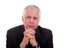 A handsome mature businessman, thinking Royalty Free Stock Image