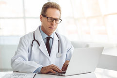 Handsome mature doctor Royalty Free Stock Images