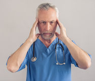 Handsome mature doctor Stock Photography