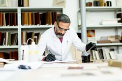 Handsome mature engineer working in laboratory in the furniture Stock Images