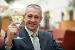 Handsome mature gray-haired businessman drinking lemonade stock photos