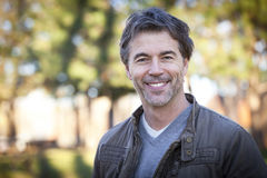 Handsome Mature Happy Man Smiling At The Camera. Royalty Free Stock Photos