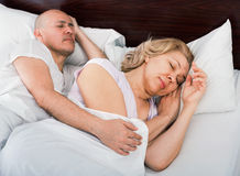 Handsome mature man and calm woman taking a nap. Handsome mature men and calm women taking a nap together Stock Image