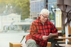 Handsome mature man with coffee and newspaper Stock Photos