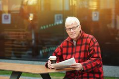 Handsome mature man with coffee and newspaper Royalty Free Stock Image