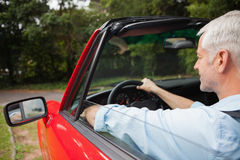 Handsome mature man driving cabriolet Stock Image