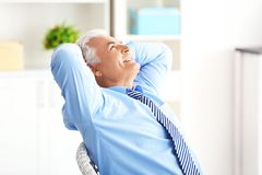 Handsome mature man in formal clothes. At home stock image