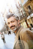 Handsome mature man hanging in the streets stock photos