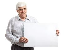 Handsome mature man holding a blank billboard Stock Photos