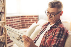 Handsome mature man at home Stock Photography