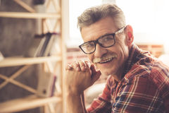 Handsome mature man at home stock images