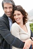 Handsome mature man hugging his wife from behind Royalty Free Stock Photo