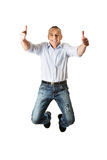 Handsome mature man jumping with thumbs up Stock Photography