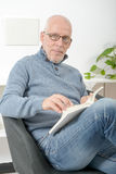 Handsome mature man read a book Royalty Free Stock Photos