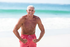 Handsome mature man showing his muscles Stock Images