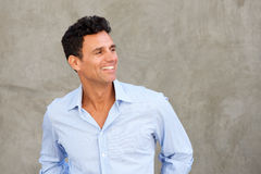 Handsome mature man smiling and looking away Royalty Free Stock Image