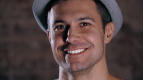 Handsome mature man smiling with perfect white teeth with hat, happy portrait
