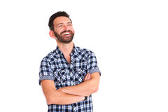 Handsome mature man standing with arms crossed and smiling Royalty Free Stock Photography