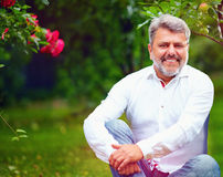 Handsome mature man in summer garden Stock Photography