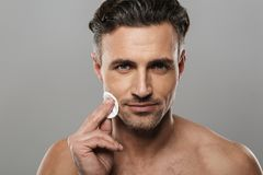 Handsome mature man take care of his skin. stock images