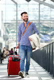 Handsome mature man traveling with suitcase Stock Photos