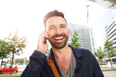 Handsome mature man using mobile phone Stock Photography