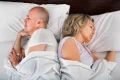 Handsome mature man and woman taking a nap Stock Images