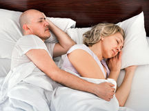 Handsome mature man and woman taking a nap. Handsome mature men and women taking a nap together Stock Photos