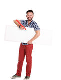 Handsome mature man writing on blank poster Royalty Free Stock Photos