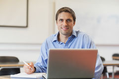 Handsome mature student learning and sitting in classroom Royalty Free Stock Photo