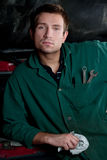 Handsome mechanic. At work in car service Royalty Free Stock Photo