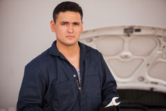 Handsome mechanic at an auto shop Royalty Free Stock Image