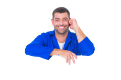Handsome mechanic with blank placard. Portrait of handsome mechanic with blank placard on white background Stock Image