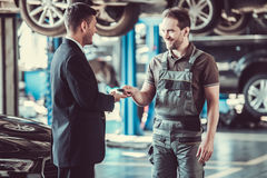 Handsome mechanic and businessman stock images