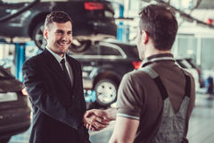 Handsome mechanic and businessman Royalty Free Stock Photography
