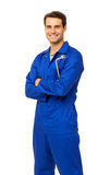 Handsome Mechanic In Overalls Holding Wrench. Portrait of handsome male mechanic in overalls holding wrench over white background. Vertical shot Stock Image