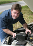 Handsome Mechanic Under Hood Royalty Free Stock Photography