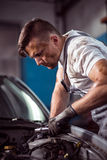 Handsome mechanic working Royalty Free Stock Photos