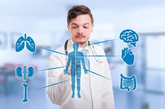 Handsome medic pressing modern medical interface Stock Photos