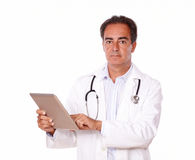 Handsome medical doctor using his tablet pc Royalty Free Stock Image